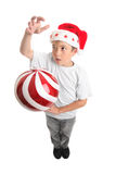 Boy and Christmas Bauble Stock Photography