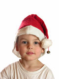 Boy in christmas cap. Isolated stock images