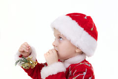 Boy in christmas clothes with toys. Isolated on white Royalty Free Stock Image