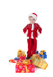 Boy in christmas clothes with toys. Isolated on white Stock Photo