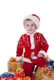 Boy in christmas clothes with toys Stock Image