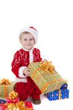Boy in christmas clothes with toys. Isolated on white Royalty Free Stock Images