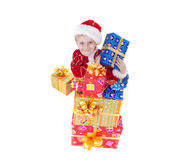 Boy in christmas clothes with toys. Isolated on white Stock Images
