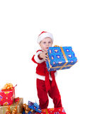 Boy in christmas clothes with toys. Isolated on white Stock Photos