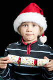 Boy with christmas cracker Royalty Free Stock Images