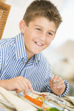 Boy At Christmas Dinner Stock Photo