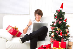 Boy on Christmas Eve with laptop Stock Photo