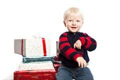 Boy with christmas gift Stock Photos