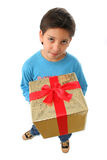 Boy with a christmas gift Royalty Free Stock Photo