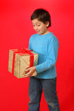 Boy with a christmas gift Stock Photo