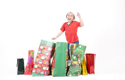 Boy with Christmas Gift. Excited boy with his Christmas gifts isolated on white Stock Photo