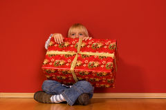 Boy with a christmas gift Royalty Free Stock Images