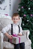 Boy with Christmas gift-box Stock Photos