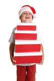 Boy with Christmas gift boxes Royalty Free Stock Photos