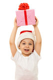 Boy with Christmas gift boxes. Isolated on white Royalty Free Stock Images