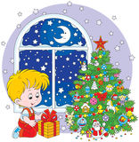 Boy with a Christmas gift royalty free illustration