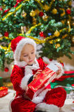 Boy and Christmas gift Royalty Free Stock Images