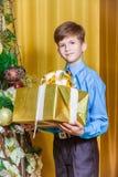 Boy with Christmas gift Stock Image