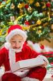 Boy and Christmas gift Stock Images