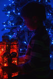Boy and Christmas gifts Stock Photography