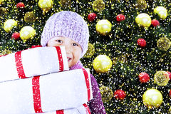 Boy with christmas gifts under tree Royalty Free Stock Photos