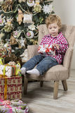 Boy with Christmas gifts Stock Photos