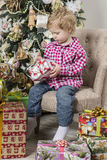 Boy with Christmas gifts Royalty Free Stock Images