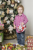 Boy with Christmas gifts Royalty Free Stock Photo