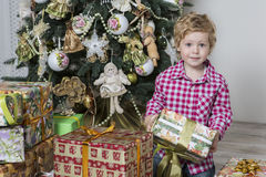 Boy with Christmas gifts Stock Photo