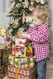 Boy with Christmas gifts Stock Images