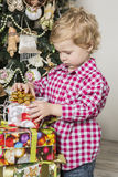 Boy with Christmas gifts Royalty Free Stock Photos
