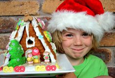 Boy and Christmas gingerbread house Royalty Free Stock Photo