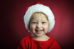 boy in christmas hat stock photography