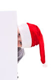Boy in the Christmas hat with a blank Stock Images