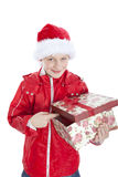 Boy in christmas hat holding present over whit. E background Stock Image