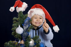 Boy on the Christmas holiday to raise finger Royalty Free Stock Images