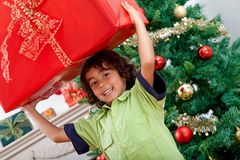 Boy with a Christmas present Royalty Free Stock Photos