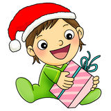 Boy with Christmas present. A happy boy holding a christmas present Royalty Free Stock Photography