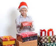 Boy with christmas present boxes Royalty Free Stock Images