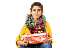 Boy with Christmas presents Stock Photos