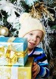 Boy with Christmas presents Stock Photos
