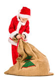 Boy and Christmas sack Royalty Free Stock Photo
