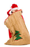 Boy and Christmas sack Royalty Free Stock Photography
