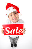 Boy with Christmas sale sign Royalty Free Stock Photography