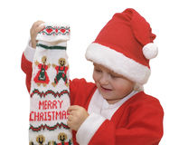 Boy with Christmas stocking. Cute young boy with Santa Claus costume and Christmas stocking, isolated on white background stock photography