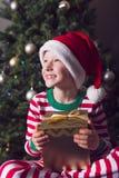 Boy at christmas time Stock Photos