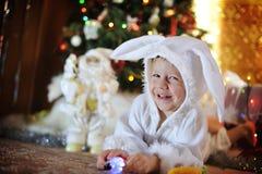 Boy and a Christmas tree Stock Image