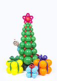 A boy with Christmas tree and balloons gifts Royalty Free Stock Photo
