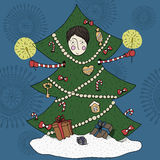 Boy in a Christmas tree costume Stock Images