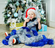 Boy with Christmas tree Royalty Free Stock Images